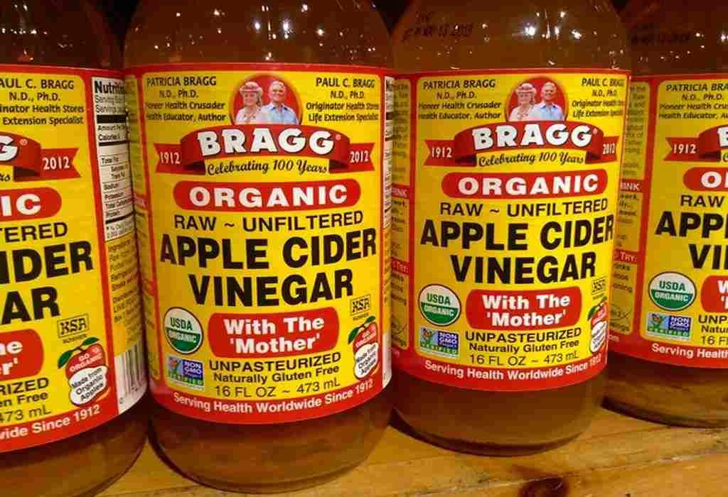 Apple cider vinegar as home remedy for dandruff.